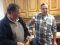 Andy Beal receives birdhouse ornament from Len Salines