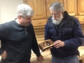 Rob Kingham receives a bowl in a log section from Hal Murray