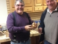 Butch Ruggiero receives a snowman decoration made by Andy Beal