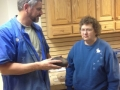 Joan Lech receives a tribal basket hollow form from Tom Buchner
