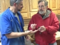 Tom Buchner receives a goblet and top made by Ed Youtz