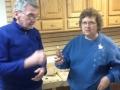 Gene Mulligan receives bird house ornament from Joan Lech