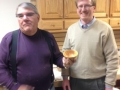 Greg Schultze receives a bowl made by Butch Ruggiero