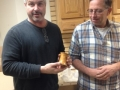 Len Salines receives a spice shaker made by Rob Kingham
